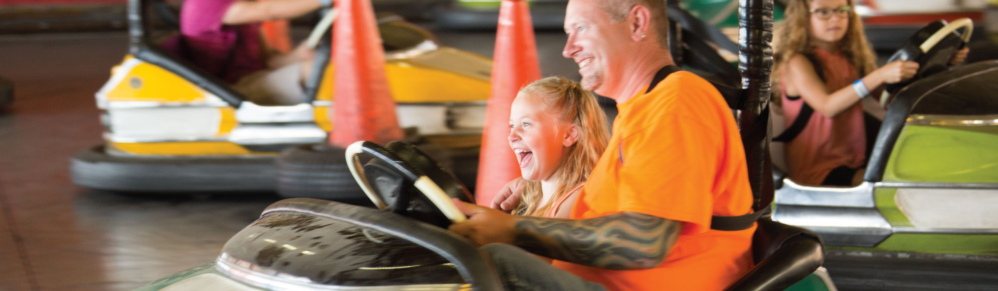 Father and daughter in Bumper Car